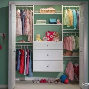A Young Girls Closet With Frequently Used Items On The Bottom Shelves And Drawers