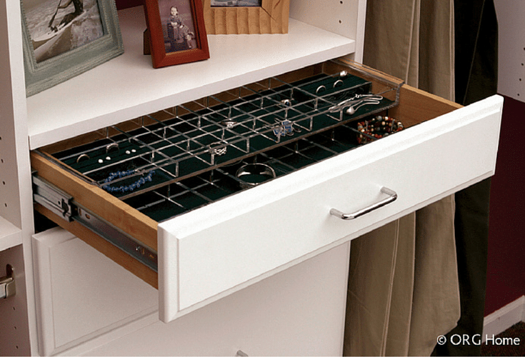Center drawers in a walk in closet design around hanging spaces