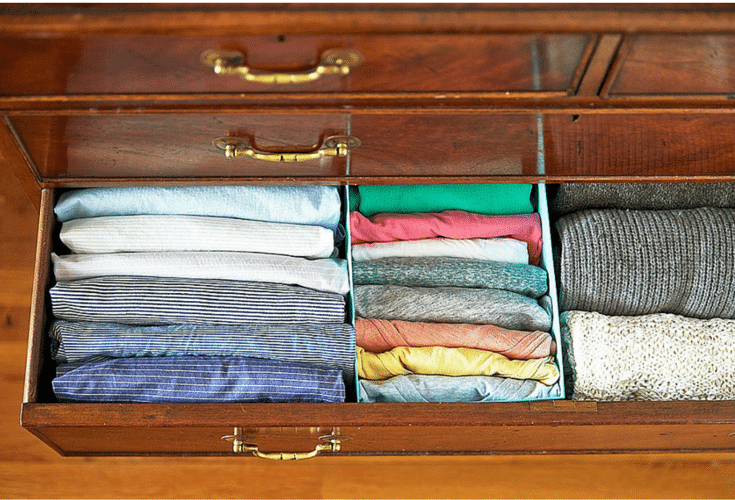 folded clothes standing up in a drawer for increased closet storage