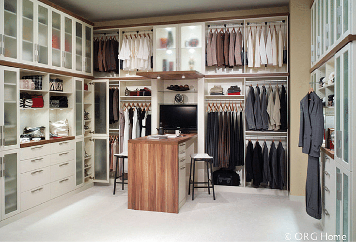 Custom walk in closet with 42 inch high countertop island