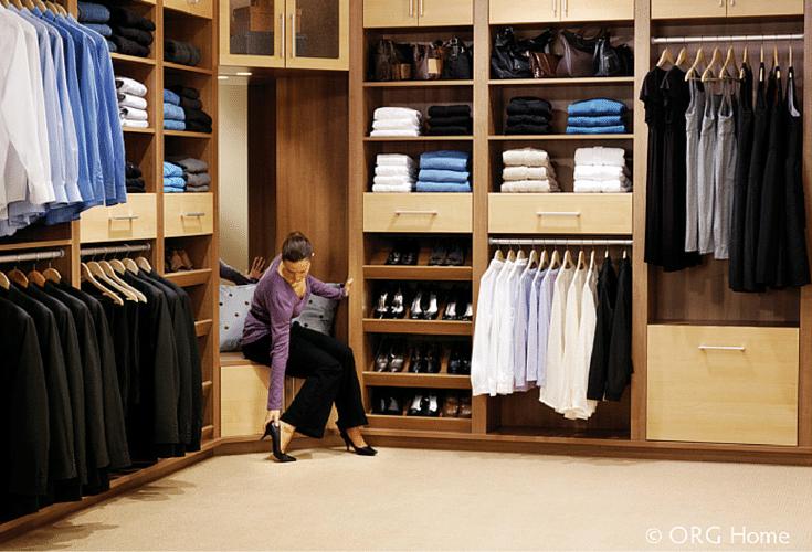 an upscale walk in closet dressing room
