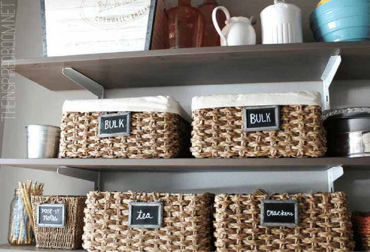 wicker baskets improve storage and orgization in this dublin ohio pantry closet