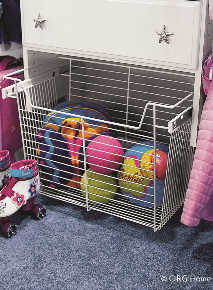Closet pull out baskets for storage of balls and games for a kids closet in Columbus Ohio.