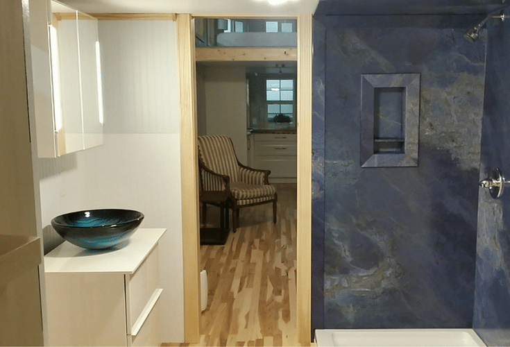 Faux marble wall panels in a luxury tiny home in north carolina