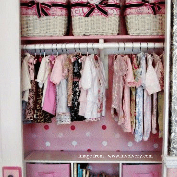 This girl's reach in closet added a fun touch with a wallpaper added to the back wall.