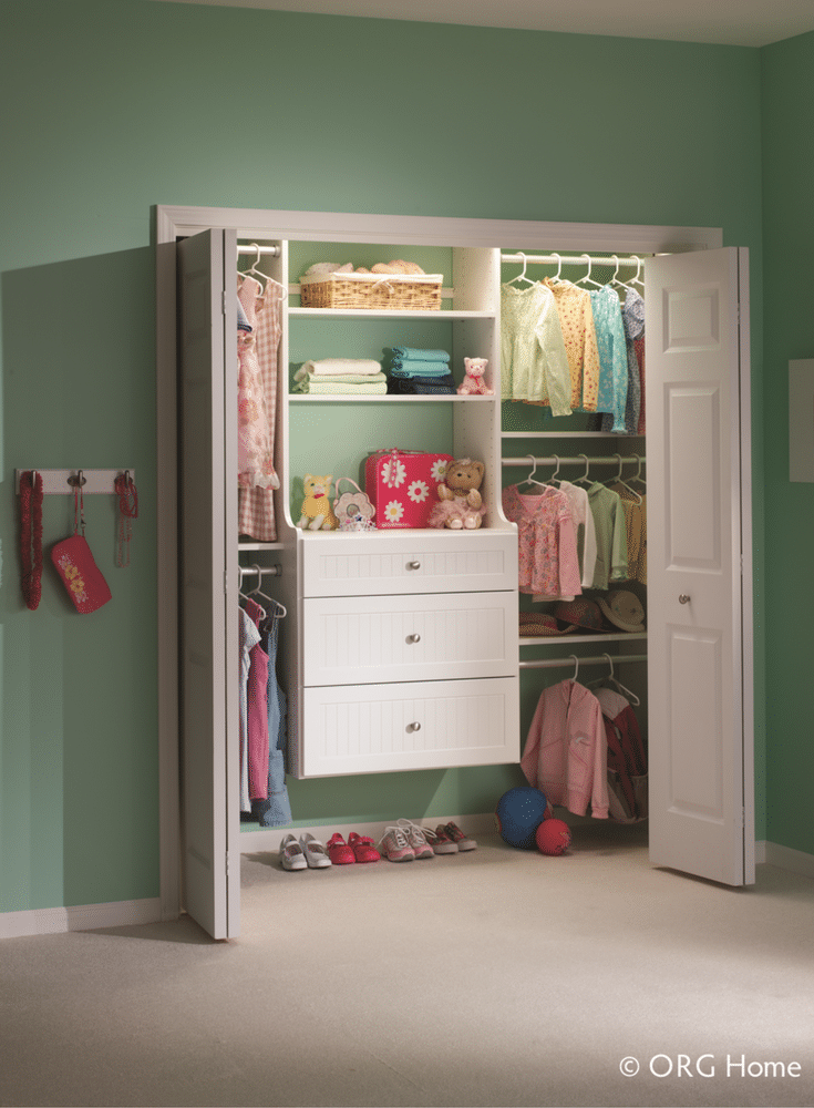 A custom nursery closet with 3 clothing rods to maximize the storage for the baby.