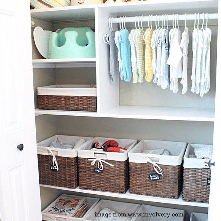 Wicker baskets provide a decorative way to store supplies in this baby nursery closet.
