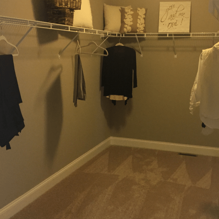 A builders grade low cost closet with wire shelving