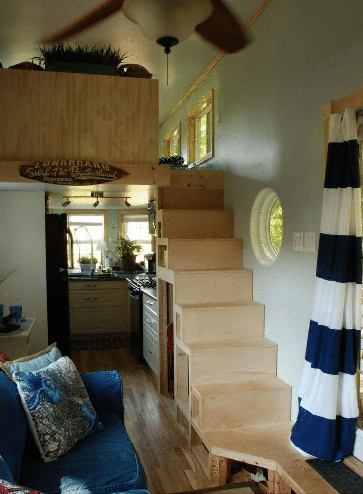 storage compartments under the stairs in a luxury tiny home