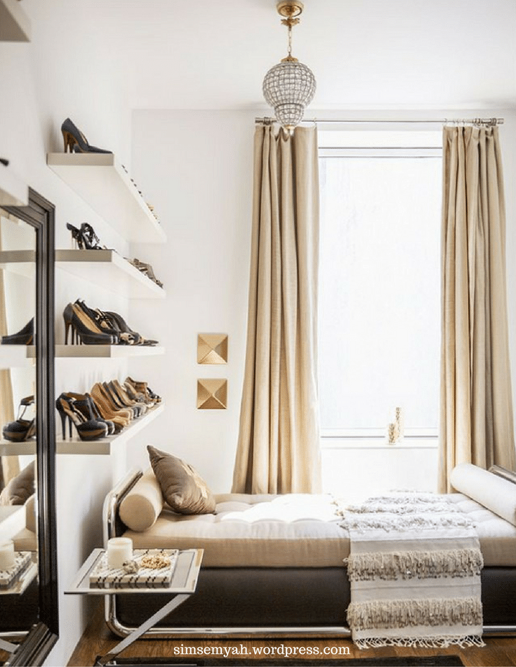 Display shelves of shoes in a luxury bedroom where closet space is limited