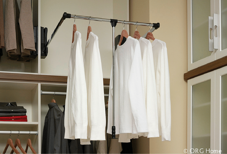 Pull down closet rods for higher shelves in a premium closet | Innovate Building Solutions