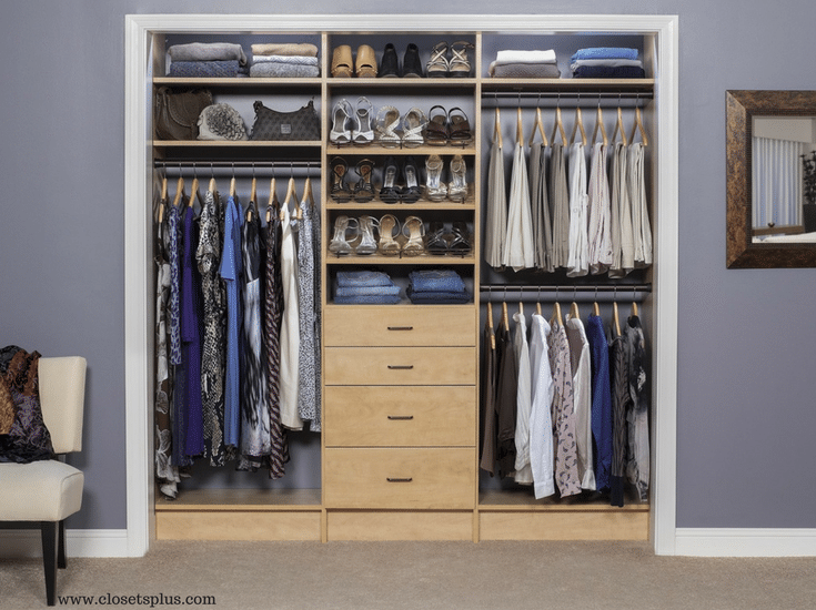 Womans reach in closet in Columbus witwh drawers and double hanging sections - Innovate Home Org