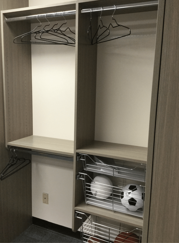 Wood grain double hung section in a laminated custom closet | Innovate Building Solutions