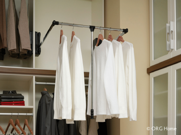 Pull down shelves in a custom closet | Innovate Building Solutions