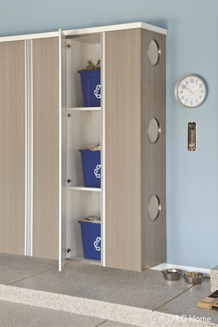 Recycling bin storage in custom garage cabinetry in a
