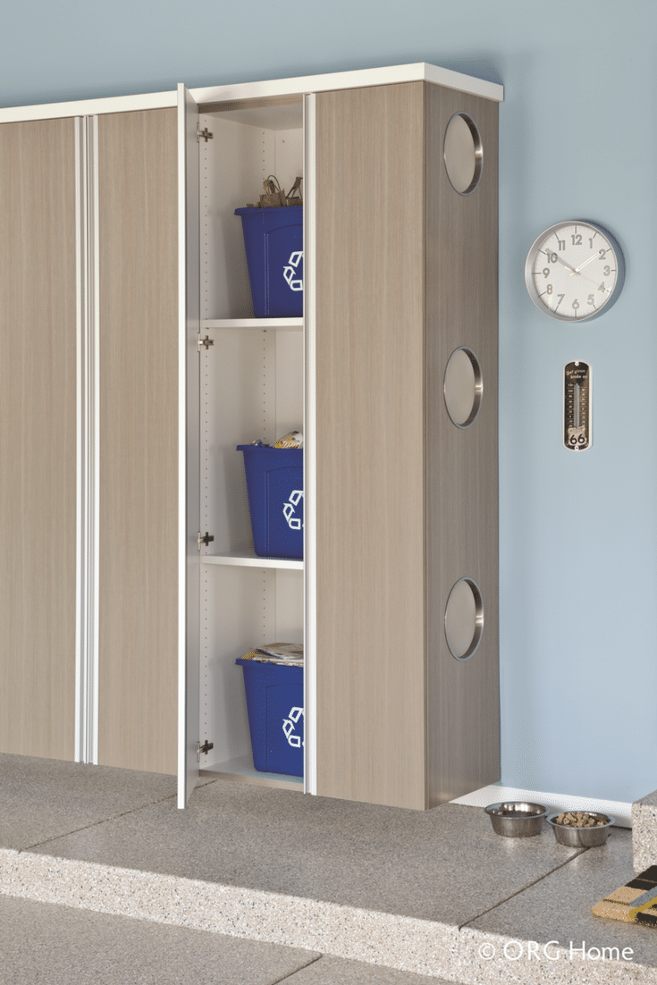 Custom garage cabinetry with recycling doors on the side | Innovate Home Org Columbus Ohio