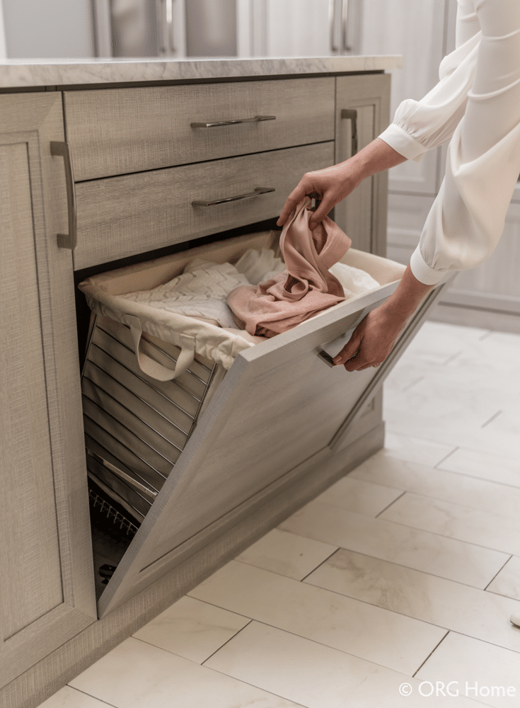 Fold down closet hamper can reduce the stress of seeing dirty clothes before laundry day| Innovate Home Org Columbus Ohio