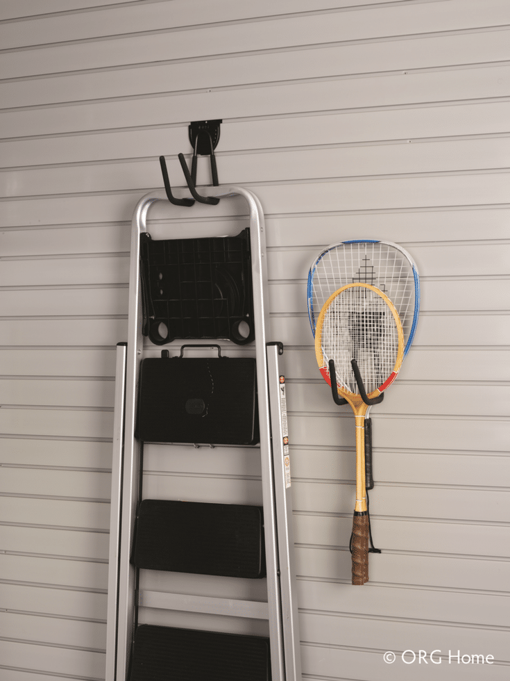 Slat wall garage organizer system to hang up ladders raquets and shovels | Innovate Home Org Columbus Ohio