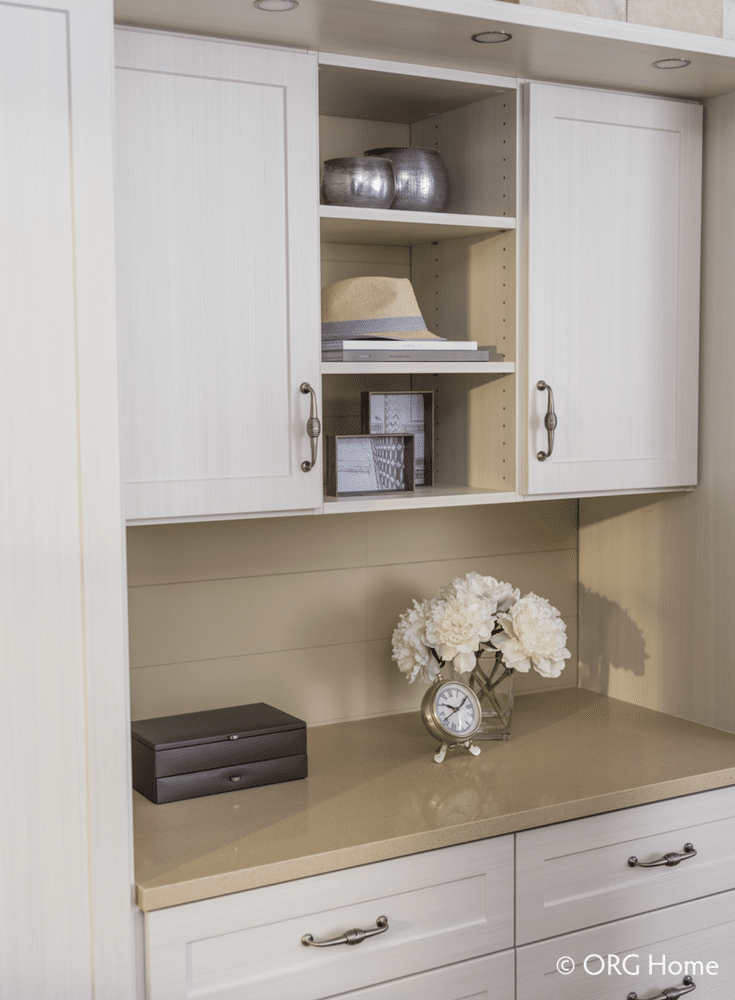 A custom bedroom closet design with drawers and a display countertop | Innovate Home Org Columbus Ohio