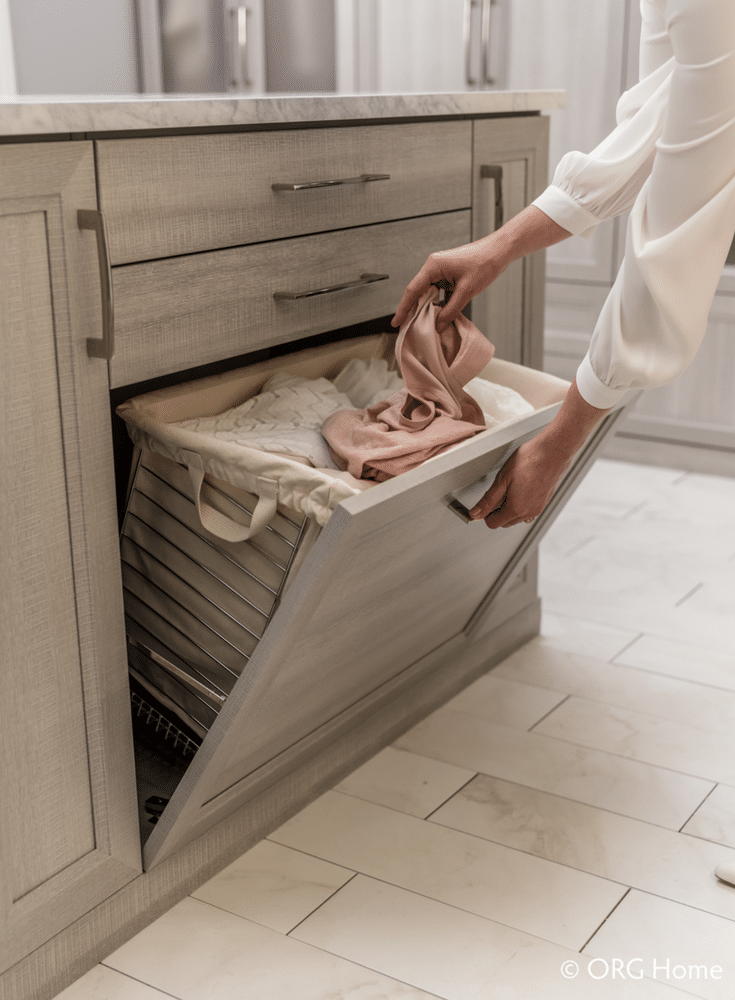 A pull down hamper is a nice closet organizer feature for a walk closet | Innovate Home Org Columbus Ohio