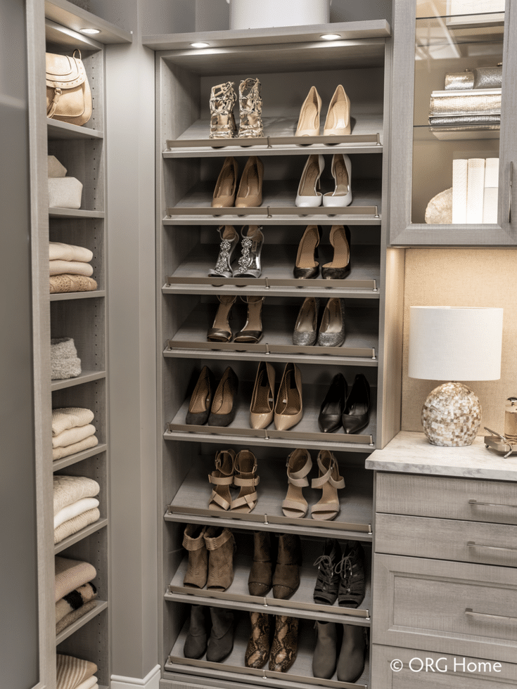 Raised shoe shelving works in a luxury custom closet - but may be too pricey for a closet for a first time homebuyer. | Innovate Home Org Columbus Ohio