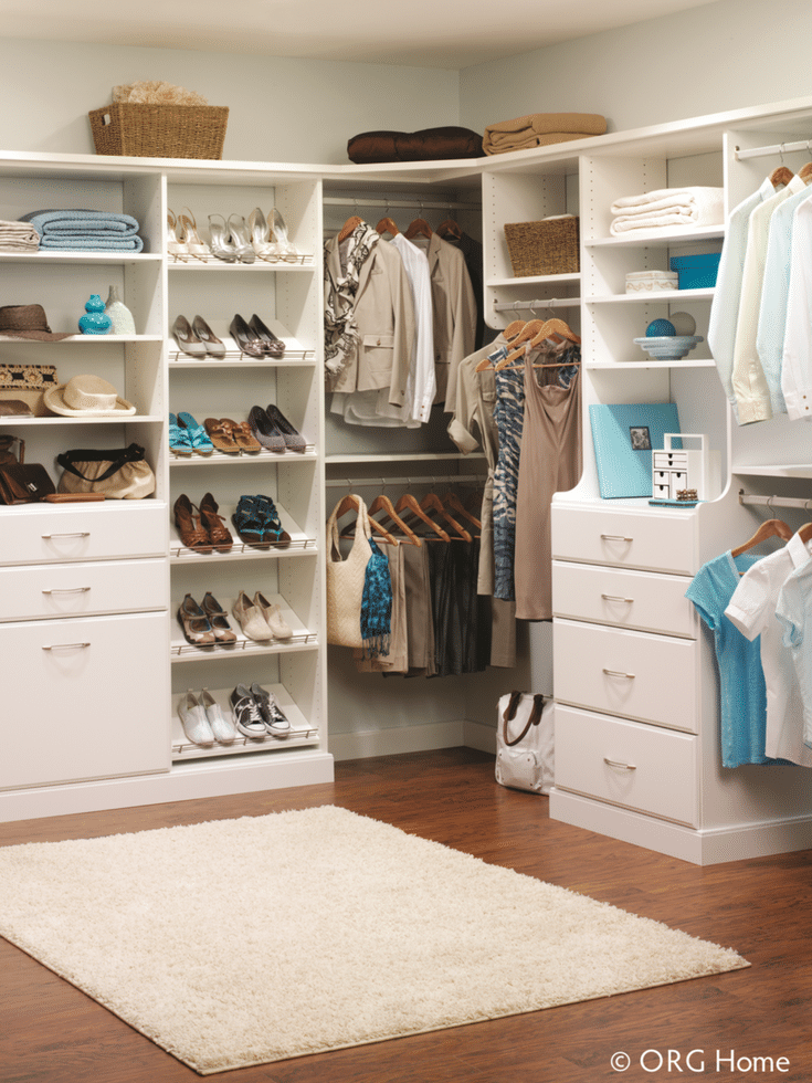 Walk in closet with a mix of shelving drawers and hanging space | Innovate Home Org Columbus Ohio