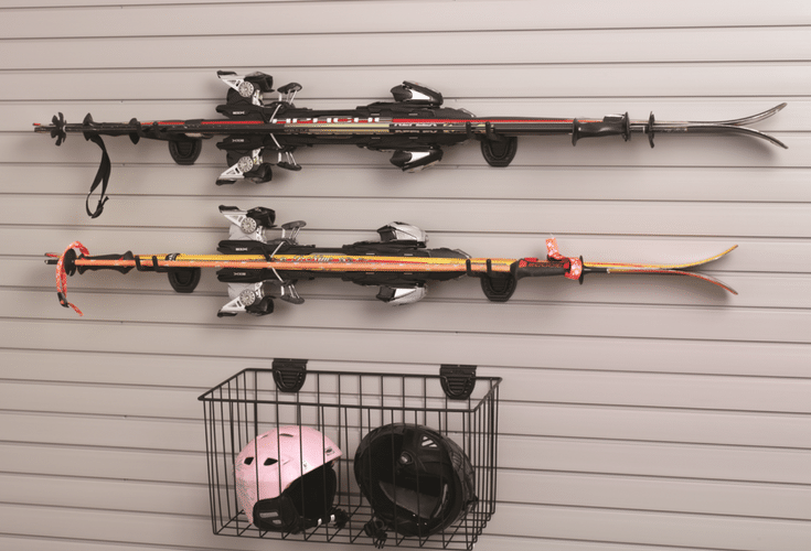 This hanging garage storage and pegboard system is a convenient place for ski poles, rakes, shovels and other things you want to get off the garage floor. | Innovate Home Org Columbus Ohio