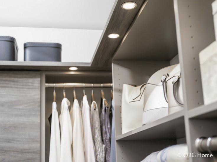 Puck LED lighting on the underside of a custom closet shelving system | Innovate Home Org Columbus Ohio