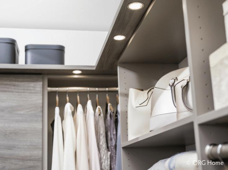 Puck LED lighting on the underside of a custom closet shelving system | Innovate Home Org Columbus Ohio