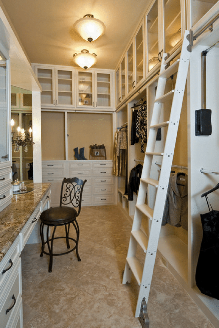 A traditional library ladder allows this owner to use height in a custom walk in luxury bedroom closet | Innovate Home Org Columbus Ohio