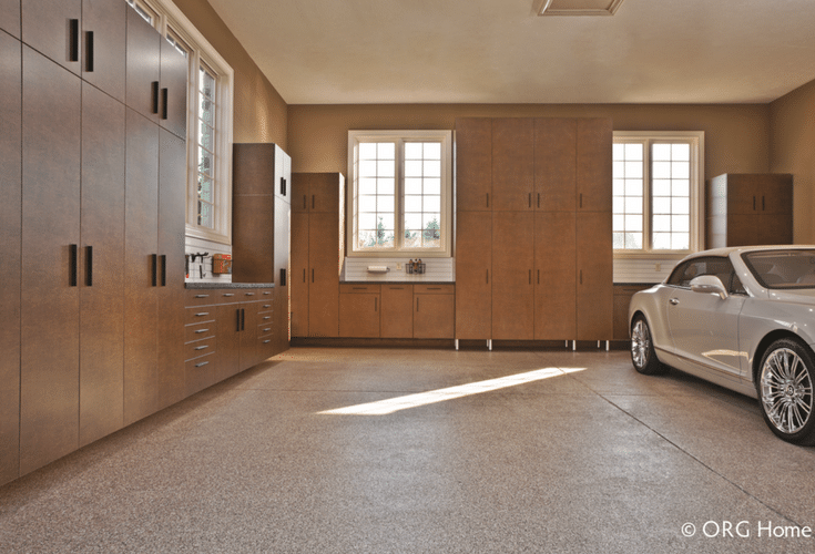 Concealed garage cabinets doors and a workbench for a clean efficient luxury garage storage area   Innovate Home Org Columbus Ohio