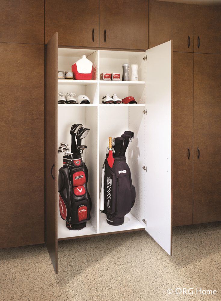 Garage cabinetry with double doors hung on a wall for golf club storage in Westerville Ohio | Innovate Home Org Columbus Ohio