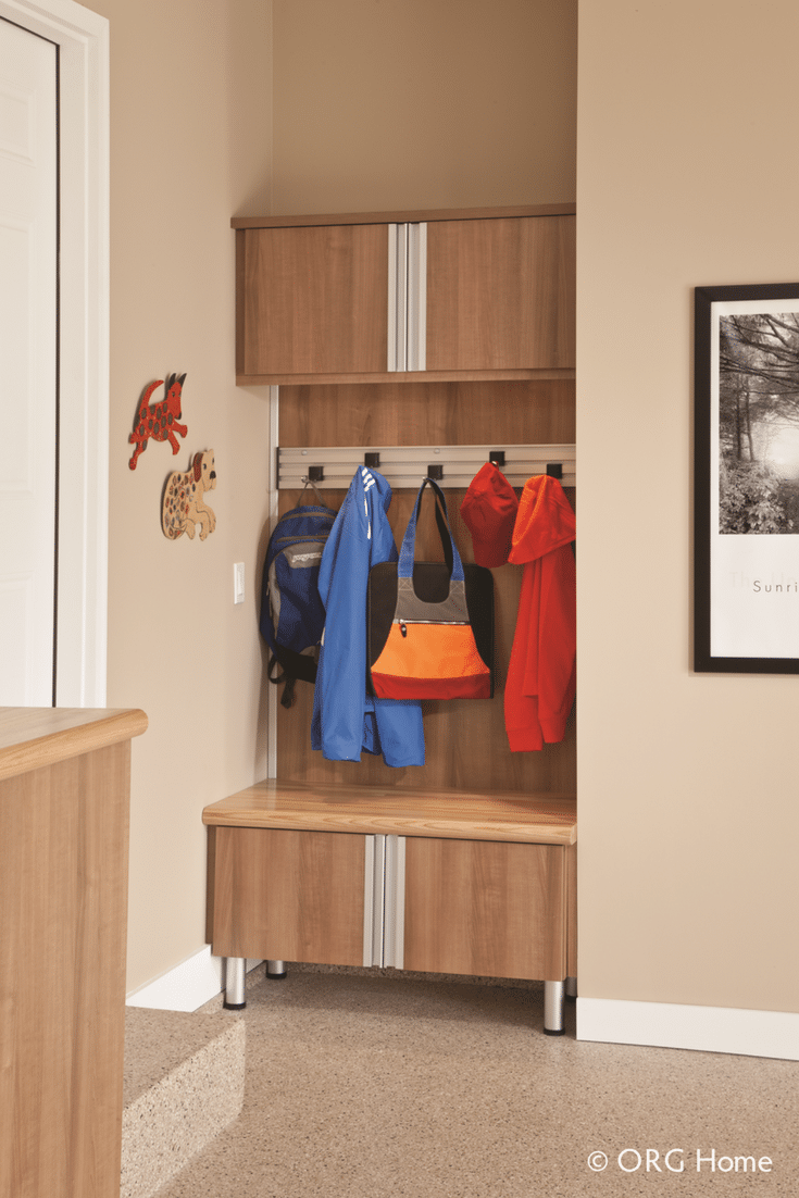 Organized boot storage station in a custom garage system   Innovate Home Org Columbus Ohio