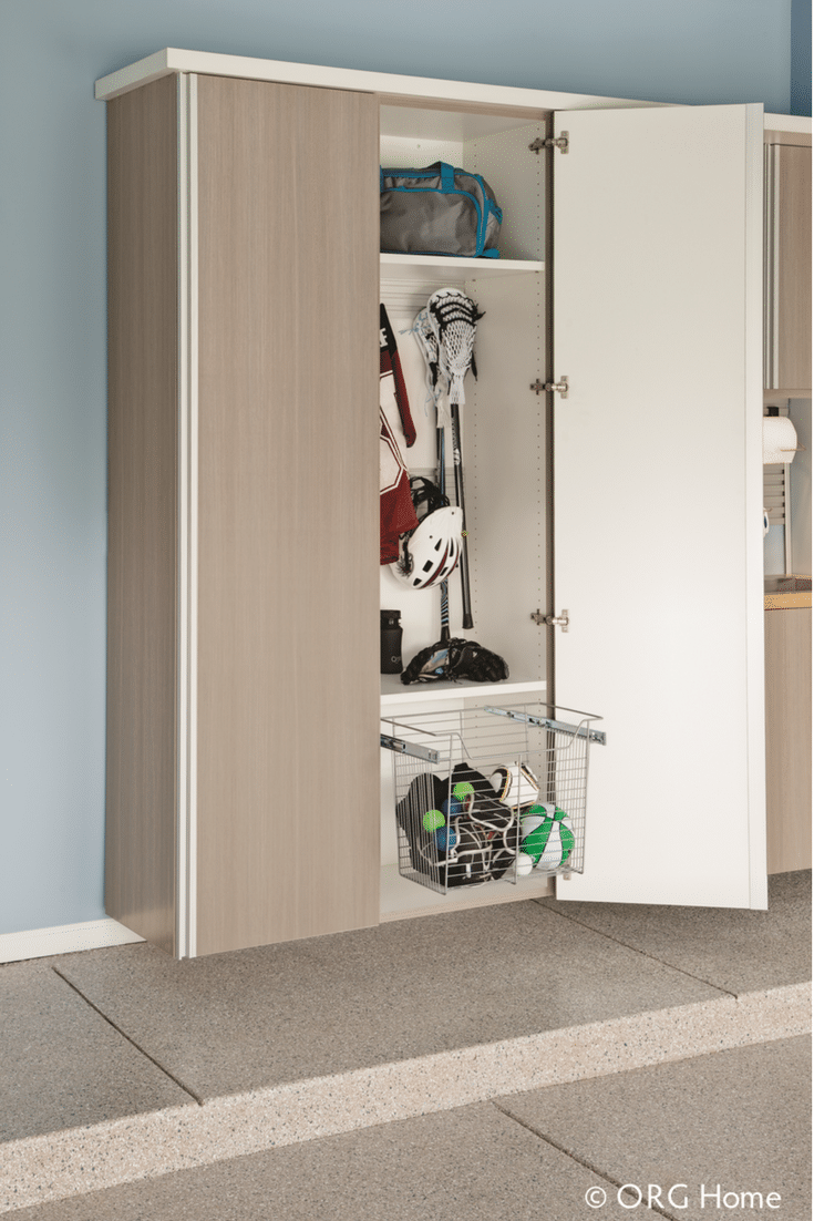 Slide out basket in a garage cabinetry system with a place for sporting goods and balls | Innovate Home Org Columbus Ohio