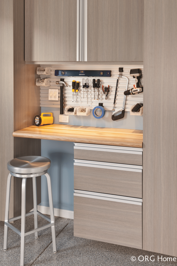 Garage storage workbench with a butcher block countertop and hanging cabinets in Westerville Ohio - Innovate Home Org Columbus Ohio