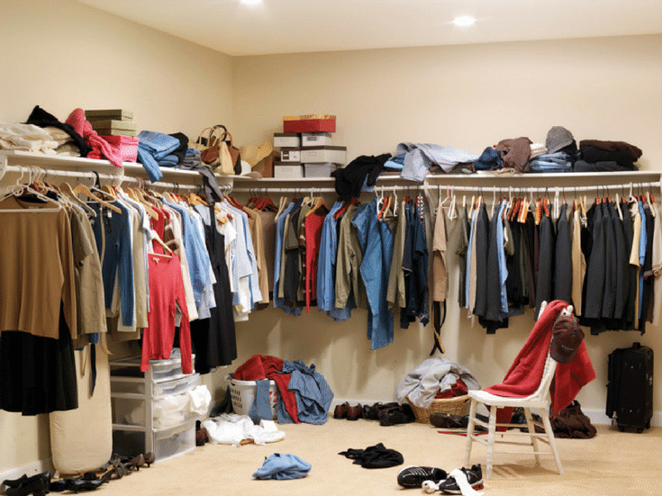 A cluttered columbus closet with too much hanging space |Before picture - Innovate Home Org