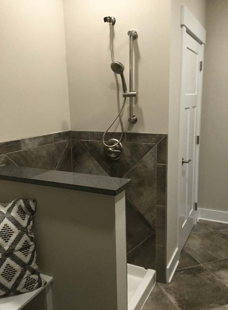 A laundry room dog shower in Columbus BIA Parade of Homes