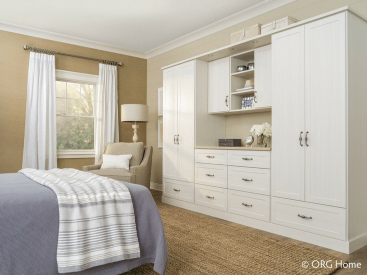 Closed cabinetry in and adjustable wardrobe closet Columbus Ohio | Innovate Home Org