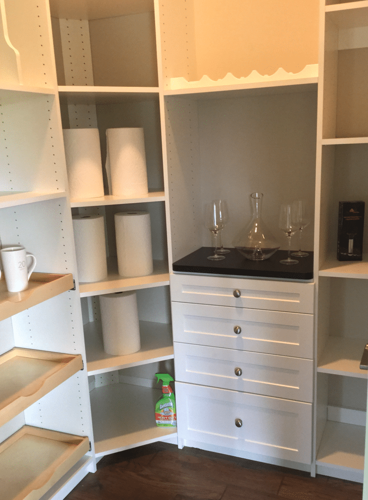 This pantry - in the Columbus BIA 2017 Parade of Homes - has adjustable shelving , pull out scoop style drawers and even a convenient place for cooking trays. | Innovate Home Org Columbus Ohio