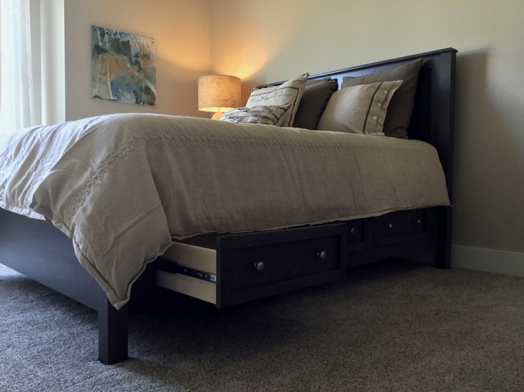 A guest bedroom in an empty nester designed home with extra storage under the bed - Innovate Home Org Columbus Ohio