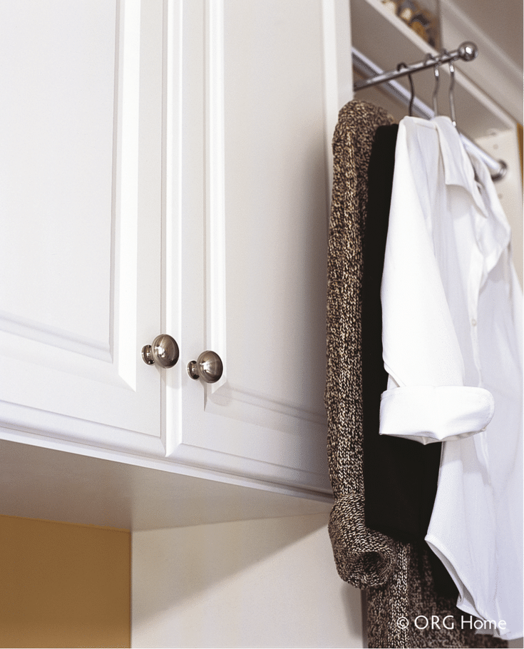 A pull out wardrobe rod for hanging in a laundry room - Innovate Home Org Columbus Ohio