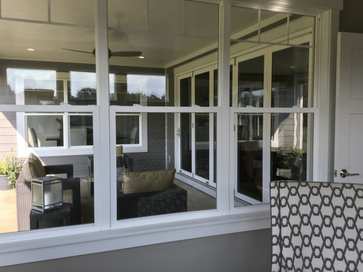 sliding glass doors in a covered outdoor patio bia parade of homes from Maple Craft Custom Builders