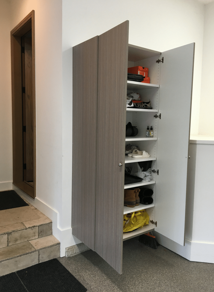 Adjustable shoe shelving in a luxury columbus garage | Innovate Home Org Columbus Ohio