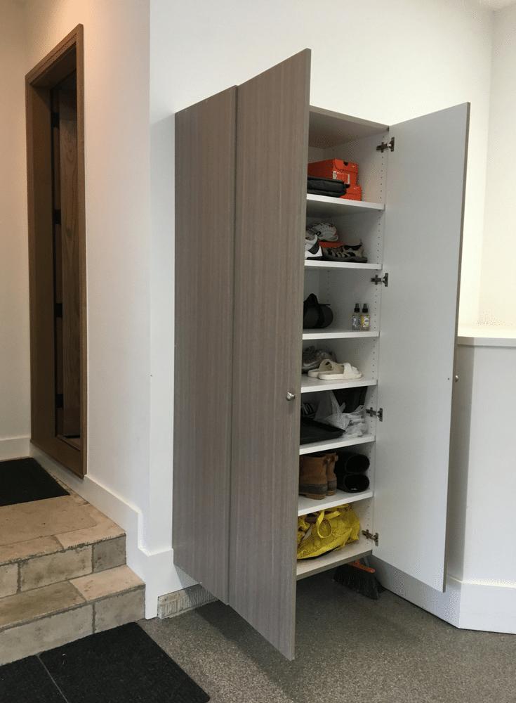 Adjustable shoe shelving in a luxury columbus garage | Innovate Home Org Columbus Ohio
