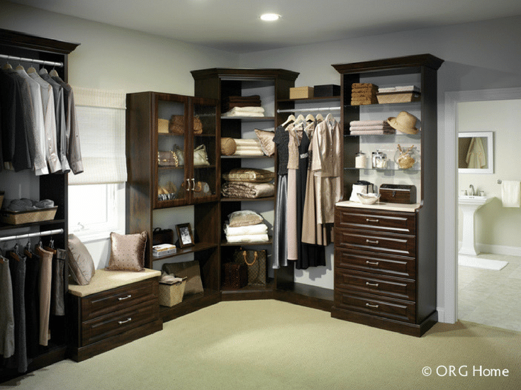 Angled corner shelves in a luxury master closet in Columbus Ohio - Innovate Home Org