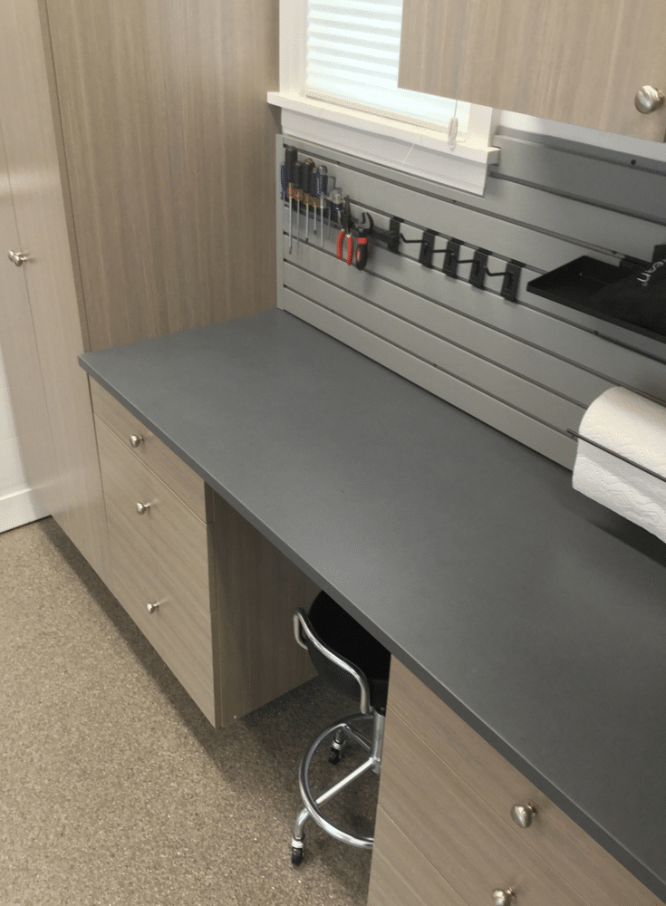 Garage workbench with gray slatwall for tool and hooks in columbus | Innovate Home Org Columbus Ohio