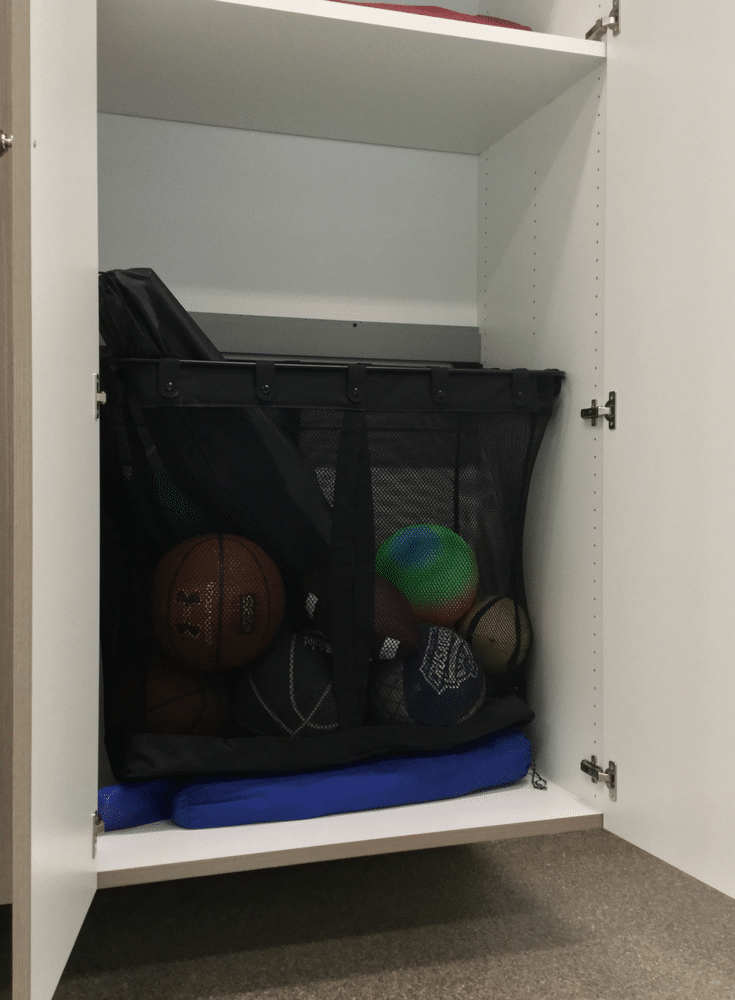 Large mesh garage sport storage basket inside custom cabinetry | Innovate Home Org Columbus Ohio