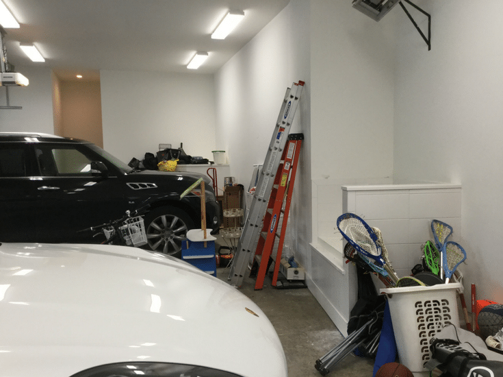 New Albany Ohio 4 car garage with items to be stored before cabinet installation | Innovate Home Org Columbus Ohio
