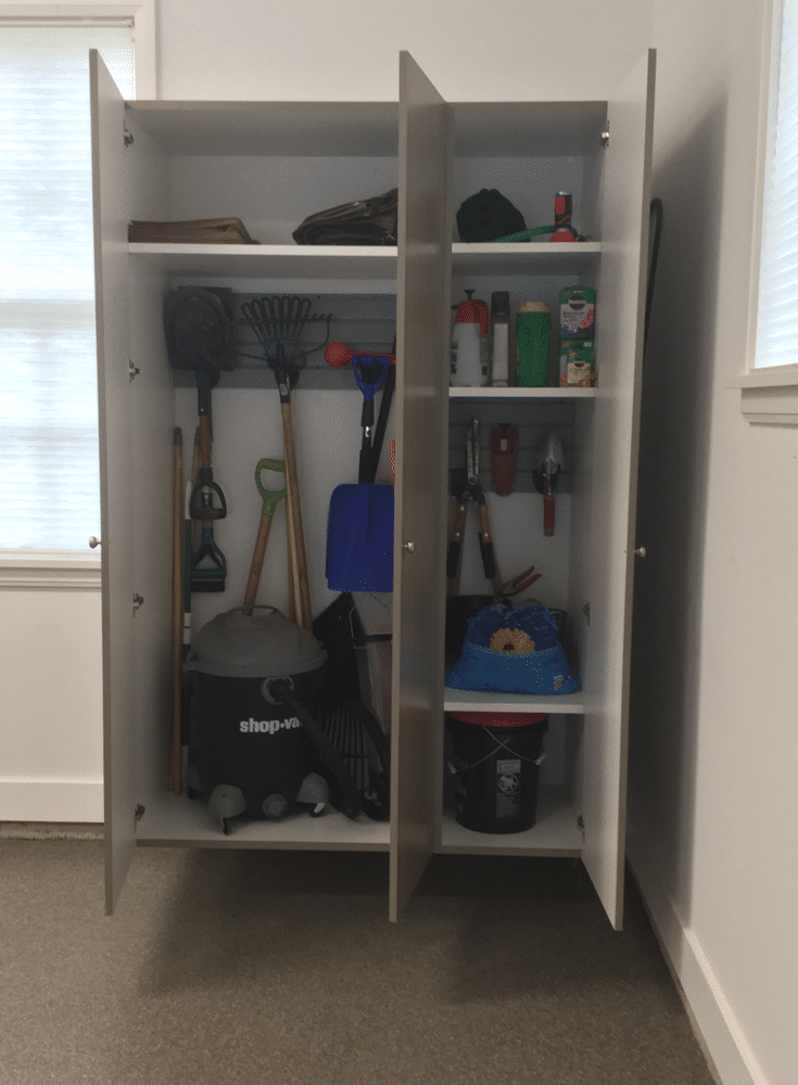 Organization slatwall inside custom garage cabinetry in New Albany suburb of Columbus Ohio | Innovate Home Org