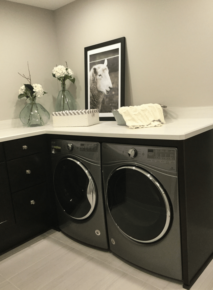 Second floor laundry with a countertop in the 2017 Columbus BIA Parade of Homes for folding and sorting in the Manor Parade Home - Innovate Home Org